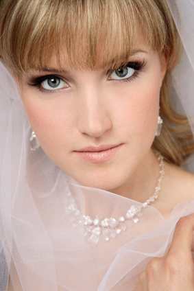 Close-up portrait of young beautiful bride in bridal veil